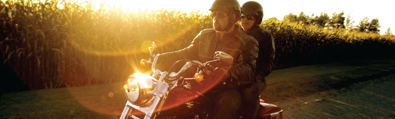 couple on a bike at sunset image